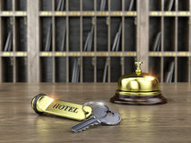 Hotel key and reception bell on reception desk Royalty Free Stock Photography