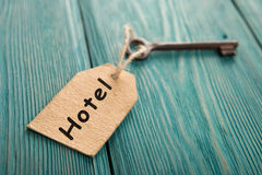 Hotel key with tag on the wooden background Stock Photos