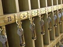 Hotel keys at reception Stock Photo