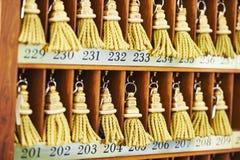 Hotel keys at reception desk counter Stock Images