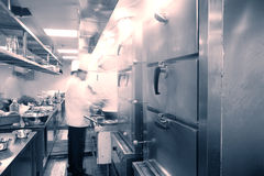 Hotel kitchen. Chef cooking at commercial kitchen - hot job Royalty Free Stock Photos