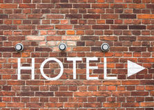 Hotel letters on a brick wall with arrow Royalty Free Stock Images