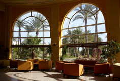 Hotel lobby with big window. And palm tree outside Royalty Free Stock Photography