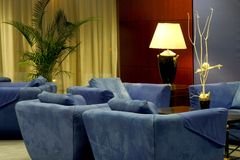 Hotel lobby with comfortable blue couches Royalty Free Stock Photography
