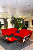 Hotel lobby interior. Interior of a modern european hotel lobby with red sofas Royalty Free Stock Photo