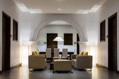 Hotel lobby interior. Cosy interior of modern hotel lobby lounge area Stock Image