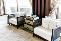 Hotel Lobby Interior Design. Fragment of the lobby of the five stars luxury hotel. Lounge area. Interior design. white chairs and sofas and vintage table Stock Photo