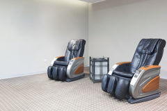 Hotel lobby interior with massage chairs Royalty Free Stock Images