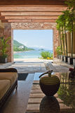 Hotel lobby overlooking ocean. Interior of luxurious hotel lobby overlooking ocean, Puerta Vallarta resort, Mexico Royalty Free Stock Images