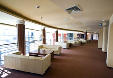 Hotel lobby sofas. A spacious interior of a modern hotel with leather sofas at the side Stock Photos