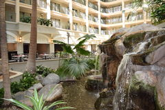 Hotel lobby with waterfall Stock Photo