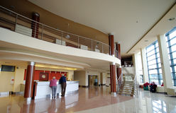 Hotel lounge. The lounge of a elegant, modern hotel, check-in desk with two tourists Stock Photography