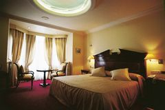 Hotel luxury bedroom. Of a suite royalty free stock photos