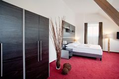 Hotel luxury bedroom double bed Stock Images