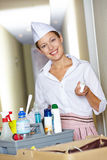 Hotel maid behind cleaning cart Royalty Free Stock Photography