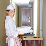 Hotel maid doing housekeeping Stock Photo