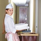 Hotel maid doing housekeeping Stock Photo