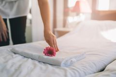 Hotel maid doing room service. She is making up the beds. MORE FROM THIS SERIES IN MY PORTFOLIO Royalty Free Stock Photo