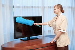 Hotel maid dusting furniture Stock Photos