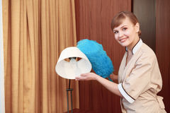 Hotel maid dusting furniture Royalty Free Stock Photo