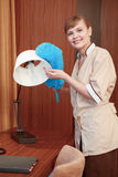 Hotel maid dusting furniture Stock Images