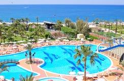 Hotel at Mediterranean Sea shore Stock Photos