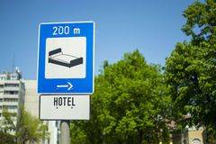 Hotel 200 metres. Blue hotel direction and distance road sign Stock Image
