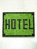 Hotel mosaic sign. Hotel mosaic on a wall stock images