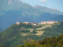 Hotel in the mountains among the green forest. Krasnaya Polyana, Sochi, Russia stock photo