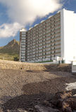 Hotel next to a mountain Stock Photography