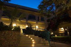 Hotel at nigt. Picture of a pretty hotel at night time with stair on the front Stock Photo