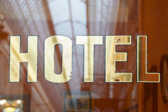 Hotel old sing on glass Royalty Free Stock Images