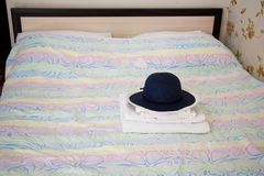 The hotel, one double bed in room, bath towels and hat - stock p. The hotel, one double bed in room, bath towels and hat Stock Photos
