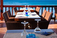 The hotel open air restaurant by the sea is waiting for guests. Stock Photography