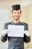 Hotel page holding paper for marketing Stock Photography