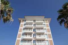 Hotel with palm trees royalty free stock photography