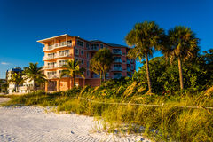 Hotel and palm trees on the beach in Fort Myers Beach, Florida. Royalty Free Stock Images