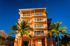 Hotel and palm trees on the beach in Fort Myers Beach, Florida. Stock Image