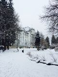 Hotel in the park in a snowy day in in Royalty Free Stock Images