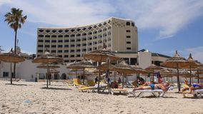 Hotel. People on the beach by hotel in Sousse, Tunisia stock video footage