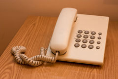 Hotel phone. A hotel phone sitting on a bedside table in a 3 stars hotel in East Europe Royalty Free Stock Photo