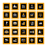 Hotel pictograms inverse. Pictogram set for hospitality industry in orange and white on black Royalty Free Stock Photo