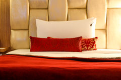 Hotel Pillow. Very comfortable red and white pillow Stock Photo