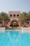 Hotel Pool. The swimming pool at the six-star Shangri-la Al Husn hotel in Muscat, Oman Royalty Free Stock Image