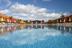 Hotel and pool. View of a pool with a hotel around it Stock Images