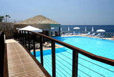 Hotel pool and bar. Bar next to a pool on the sea in the mediterrenean Royalty Free Stock Image