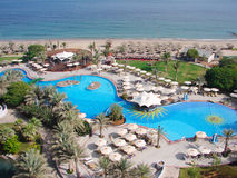 Hotel Pool on beach. Le Meridien Al Aqah Beach Resort, Fujairah, United Arab Emirates stock photos
