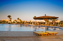 A hotel pool early morning in egyptian resort. Stock Image