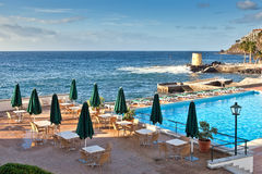 Hotel pool near ocean, Madeira, Portugal. Empty hotel pool near the atlantic ocean, Madeira, Portugal Stock Image