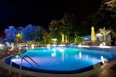 Hotel pool at night. Hotel pool illuminated by artificial lighting at night Royalty Free Stock Image
